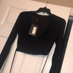 Long sleeve black crop top with ties.